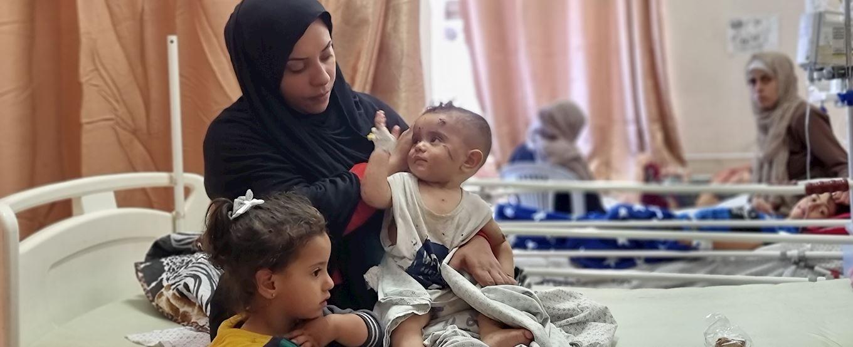 Mother nursing her injured baby