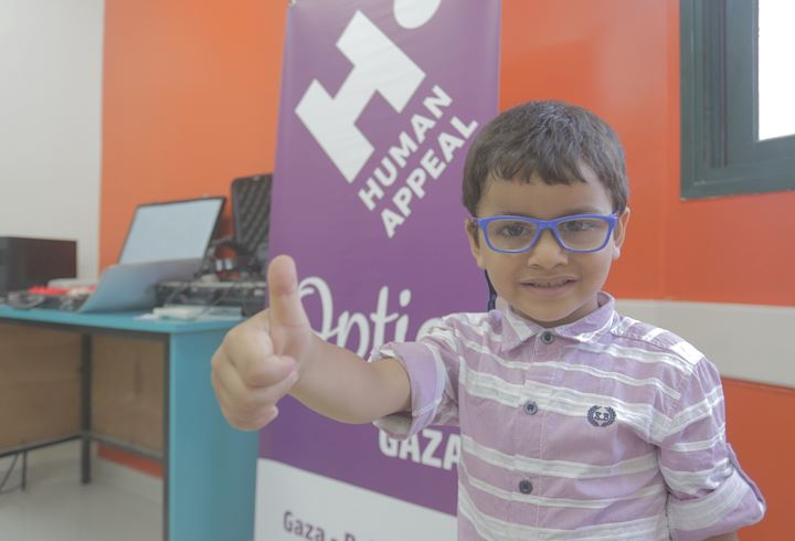 Young boy in Gaza with his new glasses