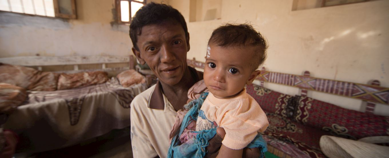 Yemen man and his baby