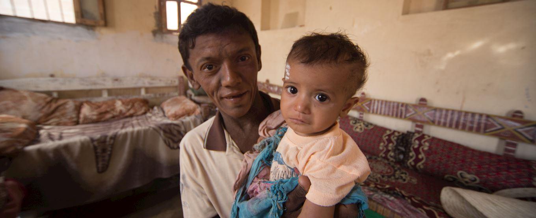 Yemen man and his baby