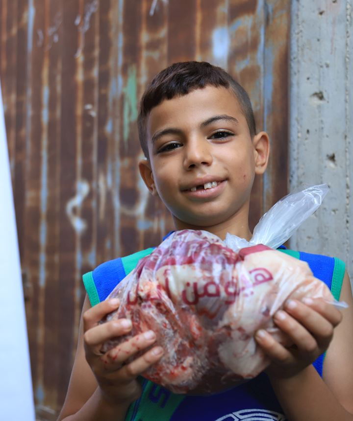 Young Palestinian boy with his Qurbani meat