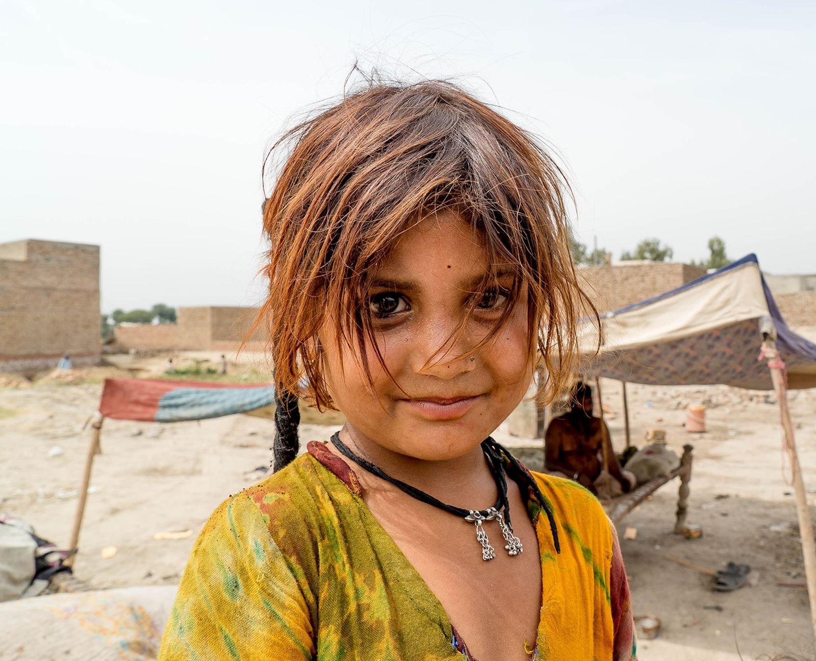 small girl on a refugee camp in Pakistan