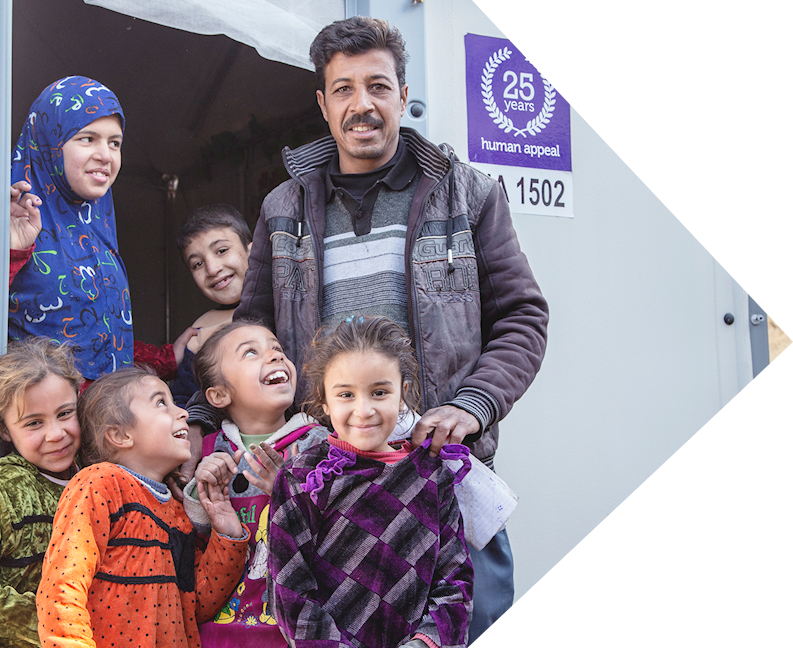 Abu and family in a human appeal refuge housing unit