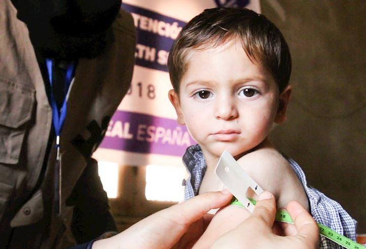 Young boy receiving healthcare in Syria