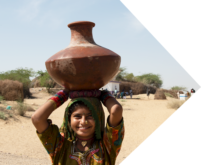 meena - premi's daughter holding a water vessel on her head