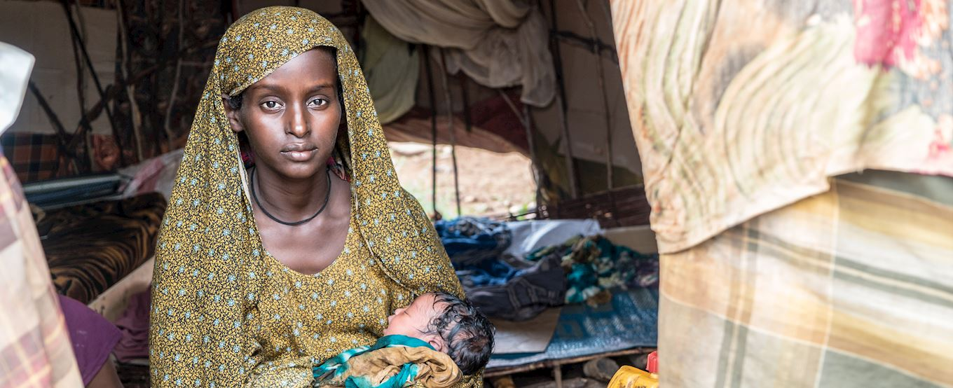 Somalia lady with her baby