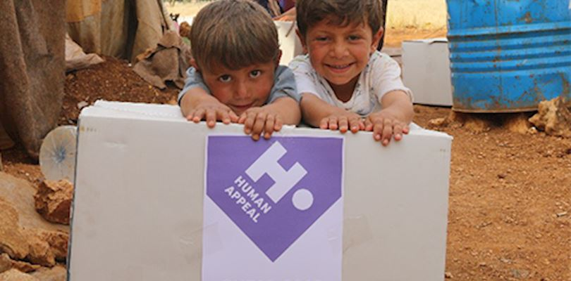two young boys in syria receiving a human appeal food parcel
