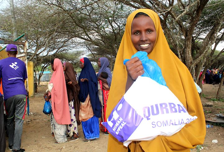 Somalian girl receiving Qurbani