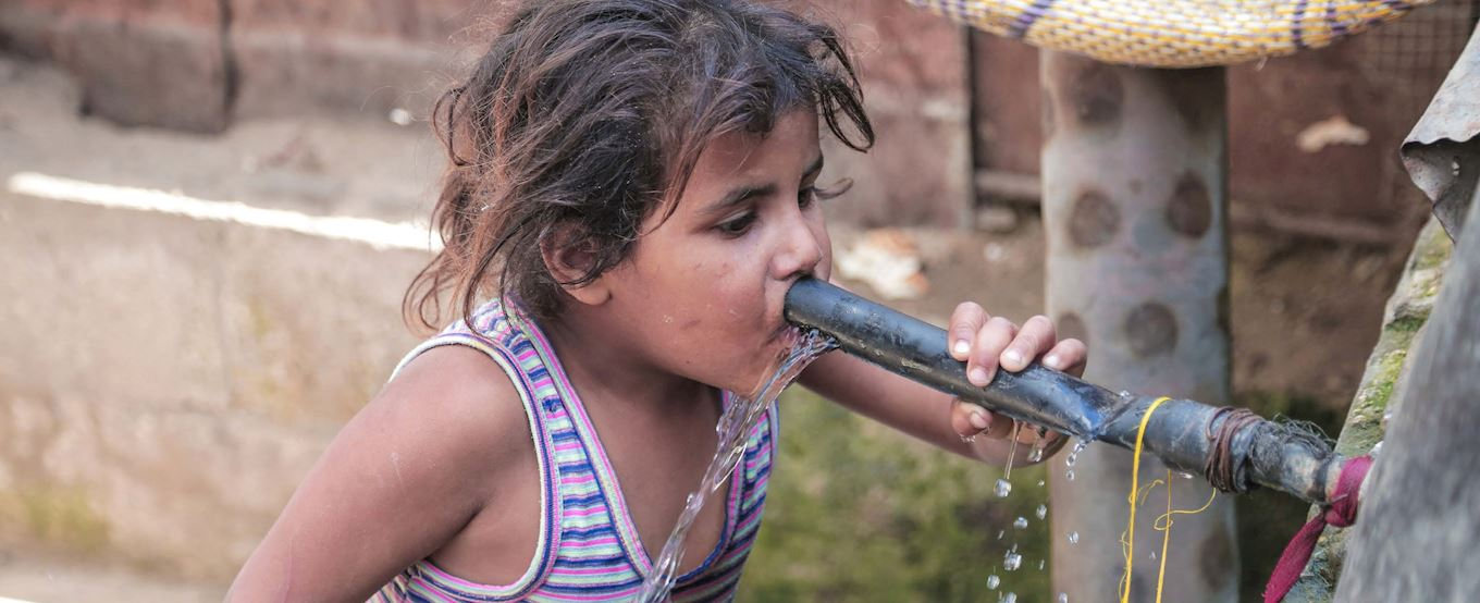Young Palestinian girl drinking water