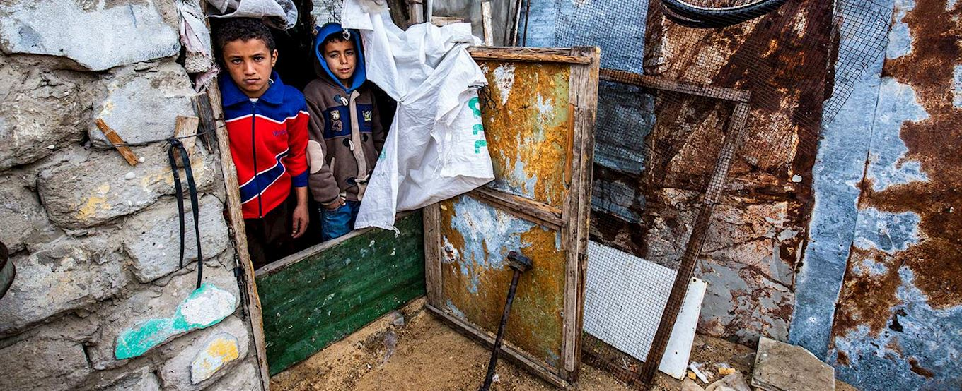 Teenage boy in a make shift shelter in Palestine