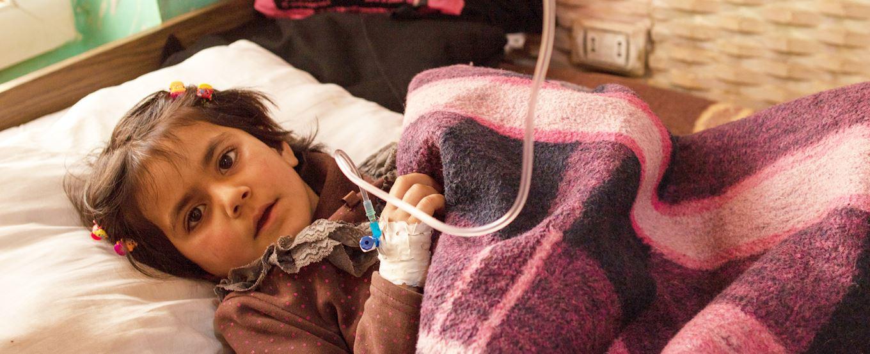 Syrian girl receiving treatment at Al Imaan Hospital