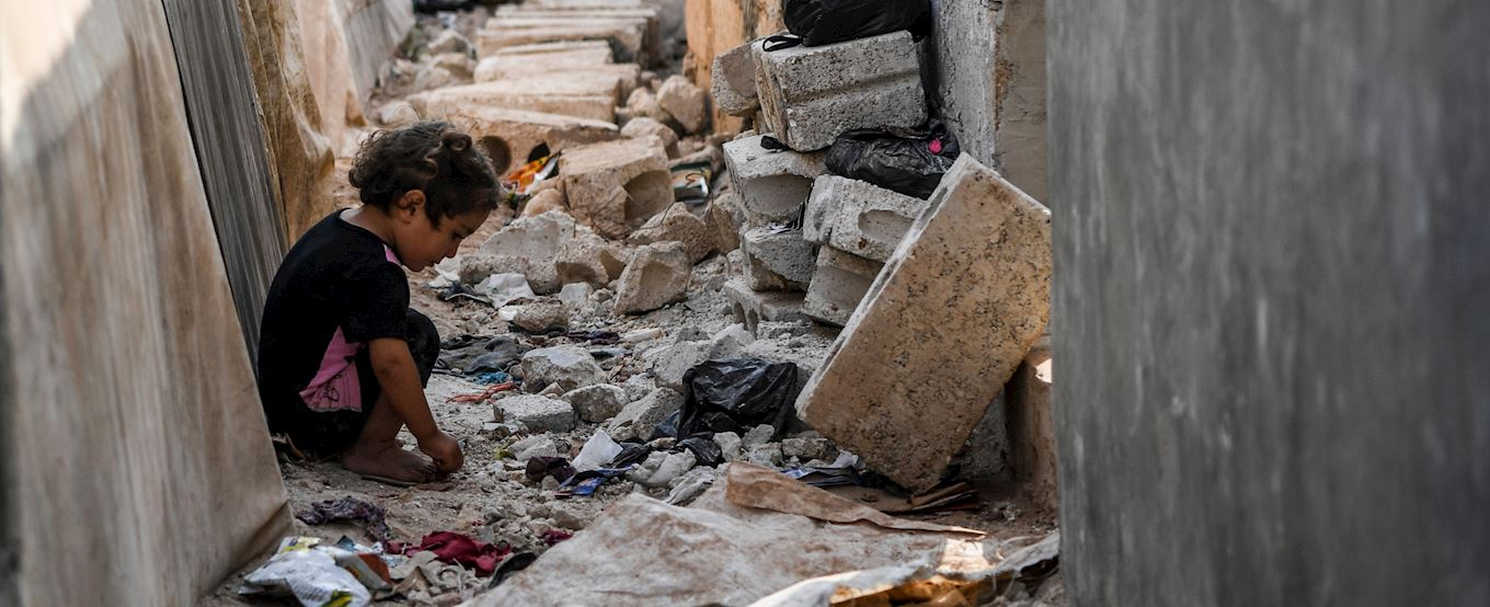 Young child in rubble