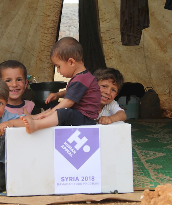 Children in syria with a human appeal food parcel