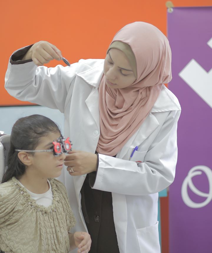 Little girl in Gaza getting her eyes checked