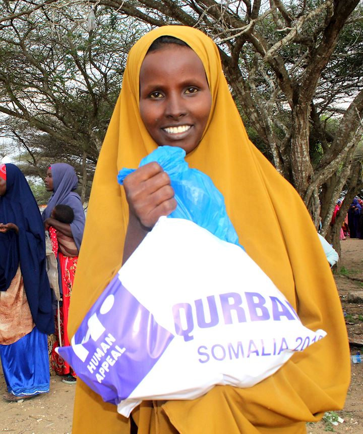 Young girl in Somalia receiving her Qurbani meat