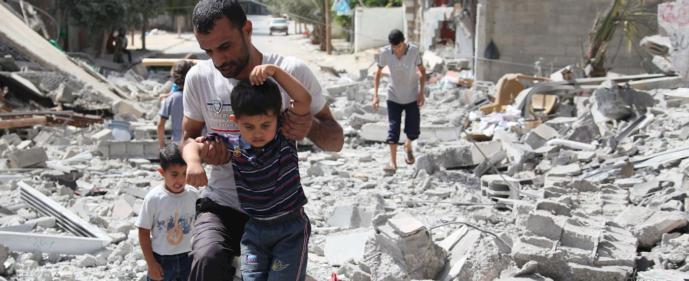 Father pulling his children out from the rubble